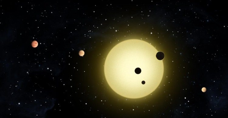 artist's impression of planets transiting in front of a star