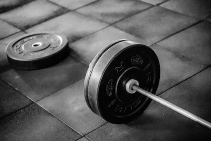 Weightlifing a barbell with plates