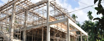 Image of a structural frame of a house in the middle of construction