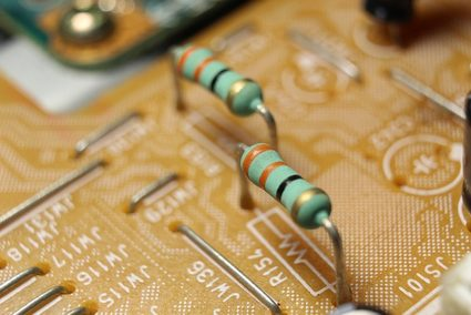 Zoomed-in image of resistors installed on a circuit board.