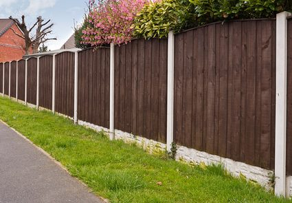 A length of fence made of wood-looking material