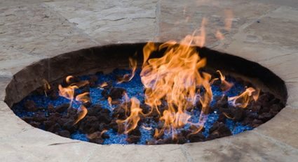 An image of a fire pit with fire glass.