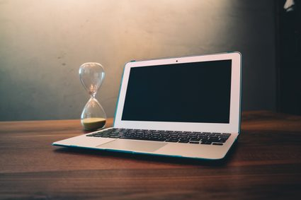 hourglass and a laptop