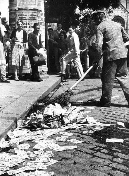 Hyperinflation in 1946 Hungary - sweeping money on the street
