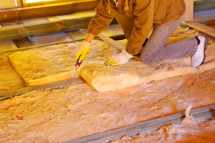 Insulation material being installed in an attic