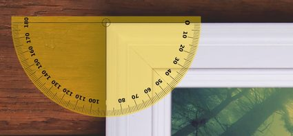 Image showing the 45° miter angles at the corners of a rectangular picture frame using a protractor.