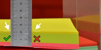 Image showing where to measure the thickness of the stack of paper using a ruler.