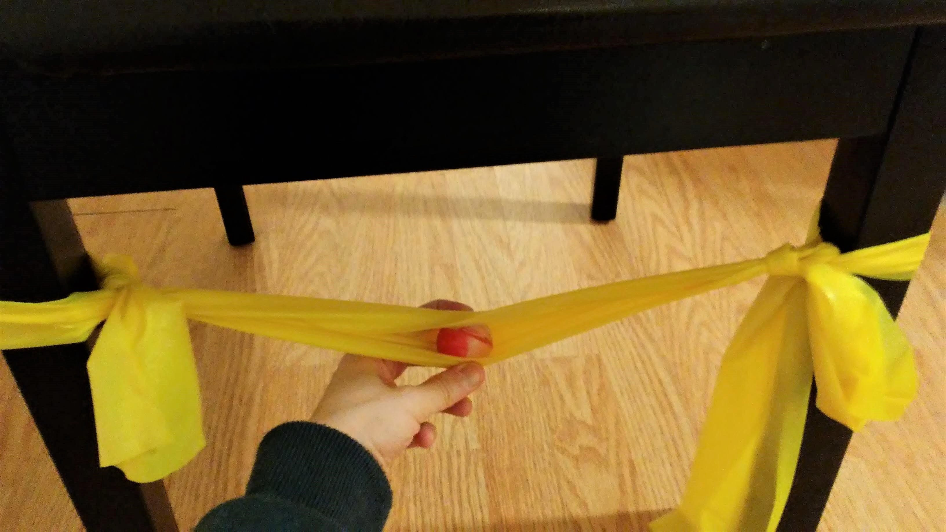 How to launch a bouncy ball using a resistance band and a chair