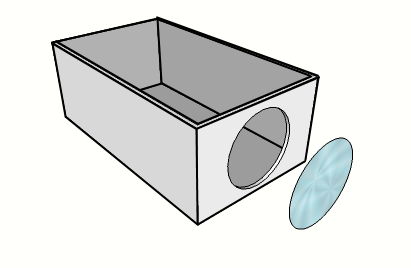 Image showing the hole made at the short end of the shoebox to fit the lens.