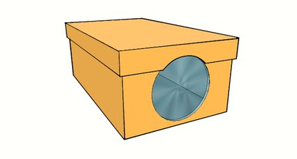 Image of the cut shoebox lid to accommodate the area of the lens.