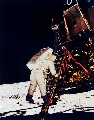Buzz Aldrin climbs down the Eagle's ladder to the surface.